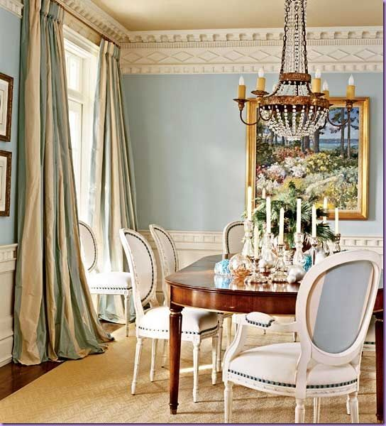 The subtle silk stripe on the draperies is a wonderful touch in this light baby blue classic dining room, adds a touch of sophistication.