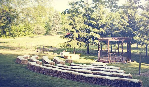 hay bale wedding ceremony seating from Peak District Country Weddings pinned from rustic wedding chic Stylish Country Weddings