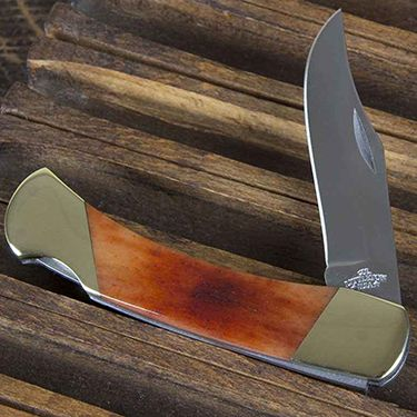 Our No. 3 Foxfire Knife. This knife features bone handles and a stainless steel locking blade. Solid brass bolsters. Dozens of hand steps provide a superior knife technically. Hand finished and hand buffed for that special look that can only be achieved at the hands of a craftsman.  http://www.colonellittleton.com/section/private-stock/pocket-knives/