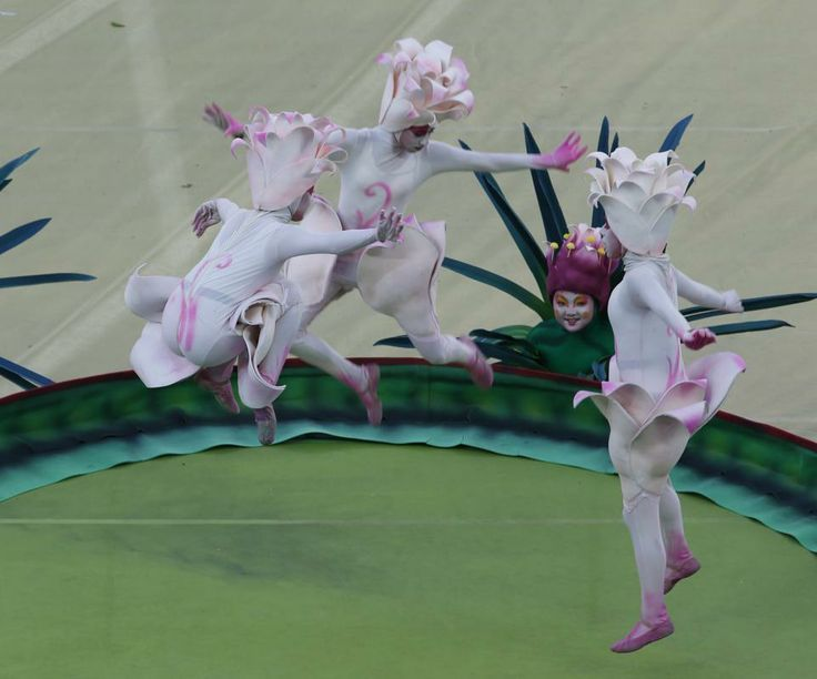 Performers jump on a trampolin during the 2014 World Cup opening ceremony at the...