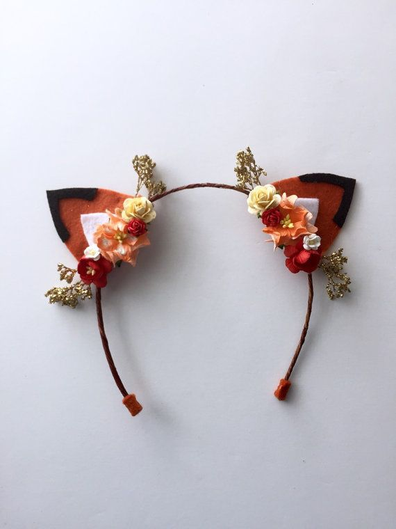 These beautiful handmade fox ears are perfect for any imaginative little one! They are adorned with flowers and the perfect amount of sparkle!