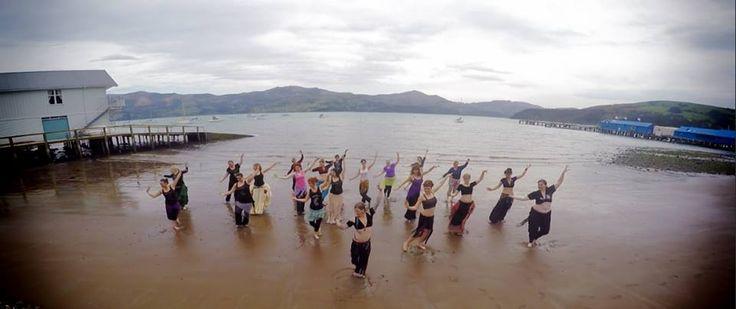 ATS on beach in Akaroa with Kristine Adams & TribalDiva Belly Dance Company in New Zealand