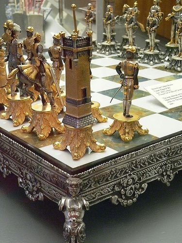 This Silvered and Gilded Bronze Vasari Figural Chess Set rests on a board of silver framed polished Italian onyx 1