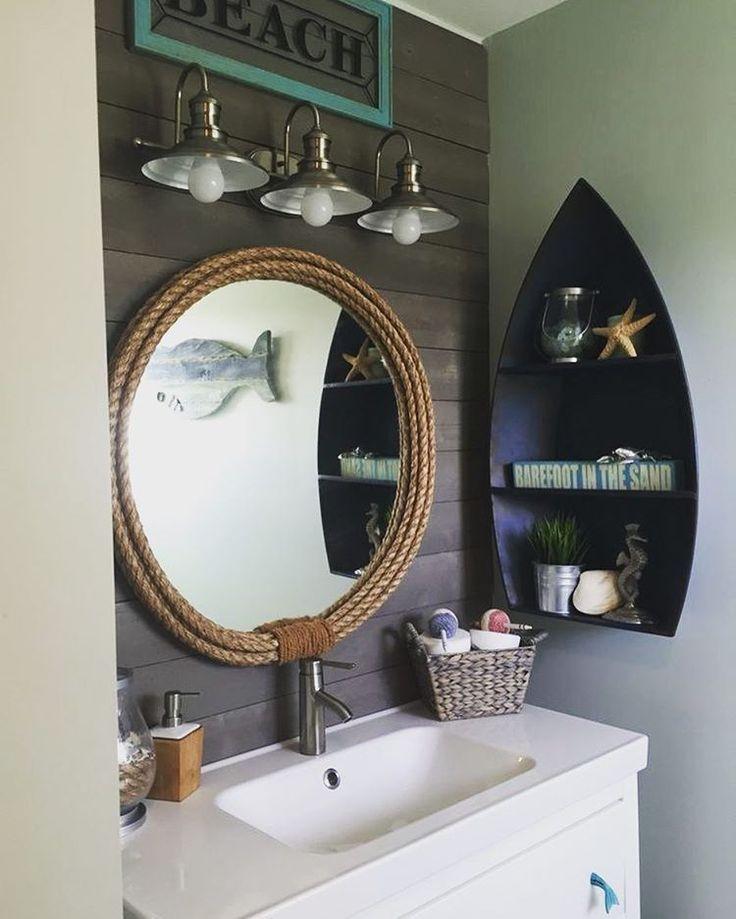 BATHROOM - boat shelves on wall above toilet tank