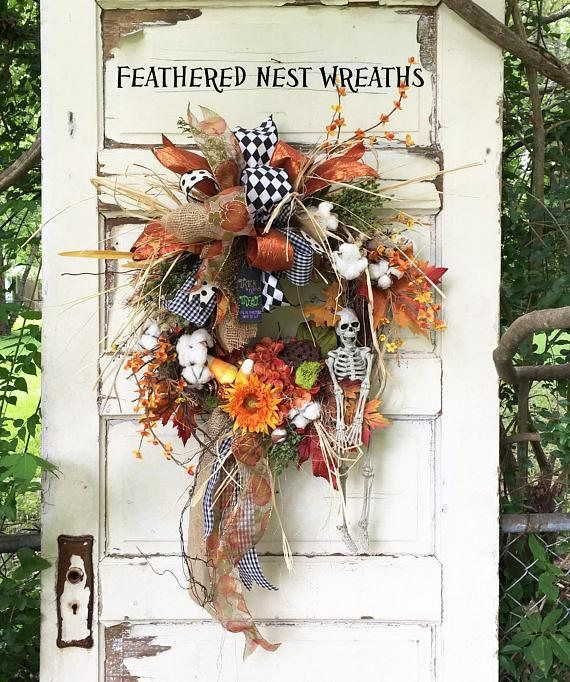 This Darlin Halloween Wreath is made on a 14 inch Grapevine Base. I have layered it with Faux Cotton Bolls, Small Cream Dried Pods, Lotus Pod, Artificial Bittersweet Stems, Orange Hydrangea, Teddy Bear Sunflower, and a Mixture of other Fall Floral Stems. I added a Little Skeleton ready to give a scare to someone!, Glittery Candy Corn and a Little Wood Trick or Treat Tag. I finished out this Wreath with an Assortment of Fall and Halloween Ribbons. This is a Smaller Wreath but I would still…