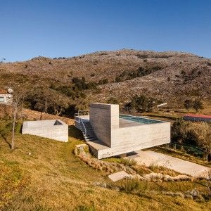 Concrete+house+with+rooftop+pool+offers+views+over+Portugal's+Serra+d'Arga+mountains
