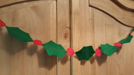 Great hand cut holiday felt Holly garland, easy way to brighten up any room over the holiday season, over picture around the stairs...give the kids their own safe decorations. Made from high quality wool blend felt this garland is very lightweight and easy to pack away and keep year after year  Bunting can come to the length you require, holly leaves measure 3 inches (7cms) and berry measures 1 inch (2.5 cms)