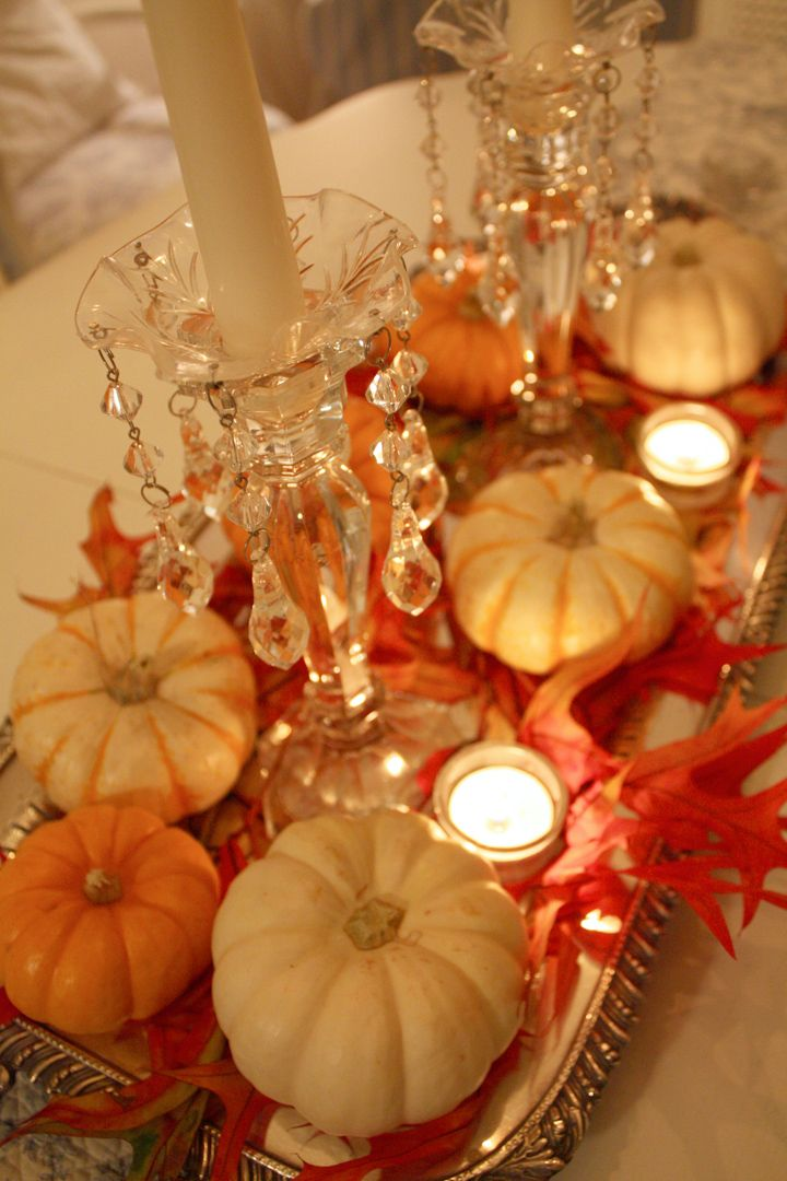 Mini pumpkins and preserved leaves on a silver platter add some tea lights and crystal candlesticks. (Variations on a theme: shells in the summer, pumpkins in the fall, and ornaments or nativity at Christmas, snowflakes for winter)