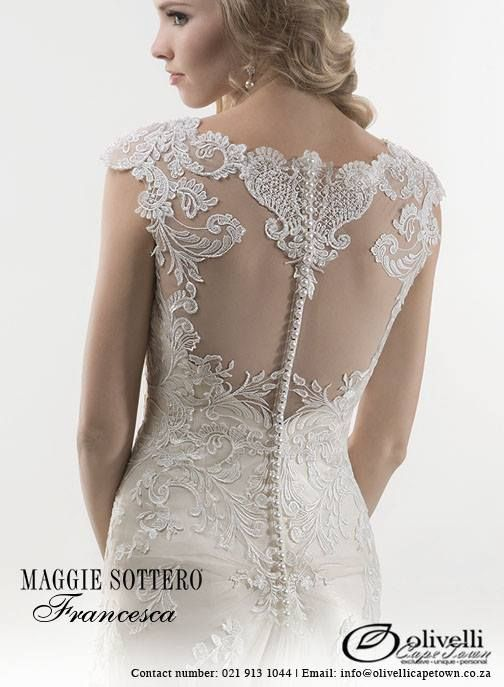 Sheath gown featuring bold floral embroidered overlay, accented with sparkling Swarovski crystals. Finished with illusion lace back adorned with crystal button closure and separate satin slip dress. Offered with Monroe slip dress or slip dress with raised back. #OlivelliCT #MaggieSottero #WeddingGown