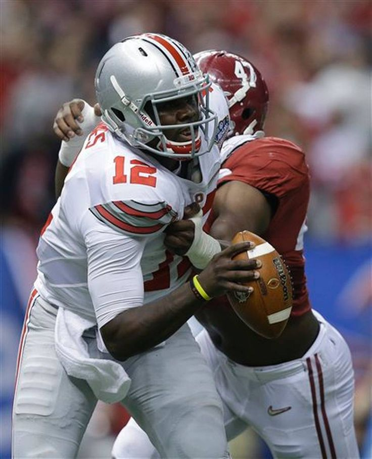 Alabama linebacker Xzavier Dickson (47) pressures Ohio State quarterback Cardale Jones (12) in the first half of the Sugar Bowl NCAA college football playoff semifinal game, Thursday, Jan. 1, 2015, in New Orleans. (AP Photo/Brynn Anderson)