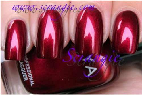 Zoya Isla...LOVE this red!!!!  Red metallic...looks red w/ darker shade at edges.  A MUST!! <3