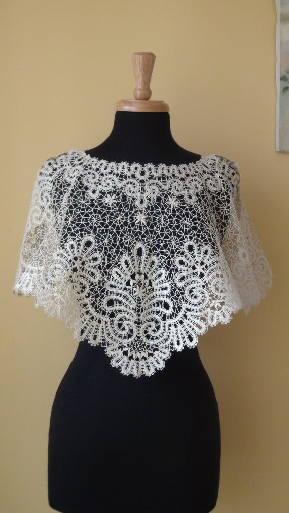 A beautiful Lace Shawl is made of famous Russian tape bobbinglace technology .  Suitable all size Off White.A metal wire in silver sparkle a bit. It