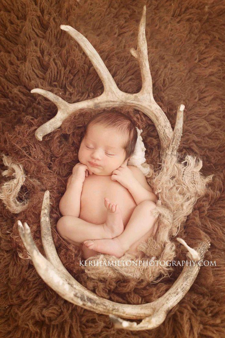 Newborn boy with deer antlers http://kerihamiltonphotography.com http://facebook.com/kerihamiltonphotography Instagram: @kerihamiltonphotography
