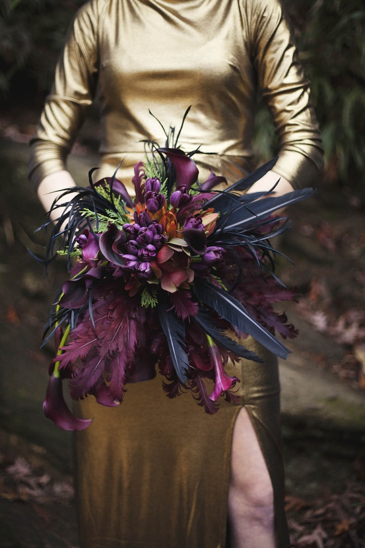 Sexy purple and black tulip, calla, and feather bouquet Love this for a bride looking to be artsy and different
