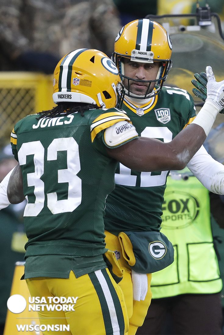 Green Bay Packers Running Back Aaron Jones Celebrates Scoring A Touchdown With Quarterback Aaron Rodgers Against In 2020 Green Bay Packers Rodgers Green Bay Green Bay