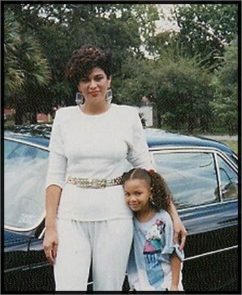 Sassy Beyonce, as a little girl, standing next to her mother, Tina Knowles-? {Well, she's married now}