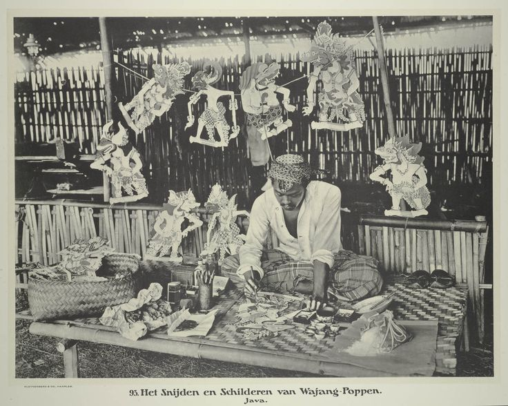 Carving and painting Wajang Kulit shadow puppets, Java. Photograph by Jean Demmeni, ca.1913