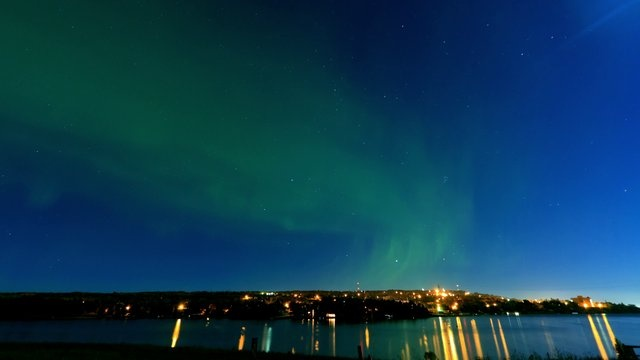 Aurora Borealis over Portage Canal - September 30th, 2012 by Defined Visuals. A mild display of Aurora activity over the Portage Canal in Houghton, MI. It takes a pretty active show to get this far south, but unfortunately an almost full moon took away quite a bit of its thunder.