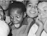 Extraordinarily excited child at a Pittsburgh cotton candy booth, circa 1945