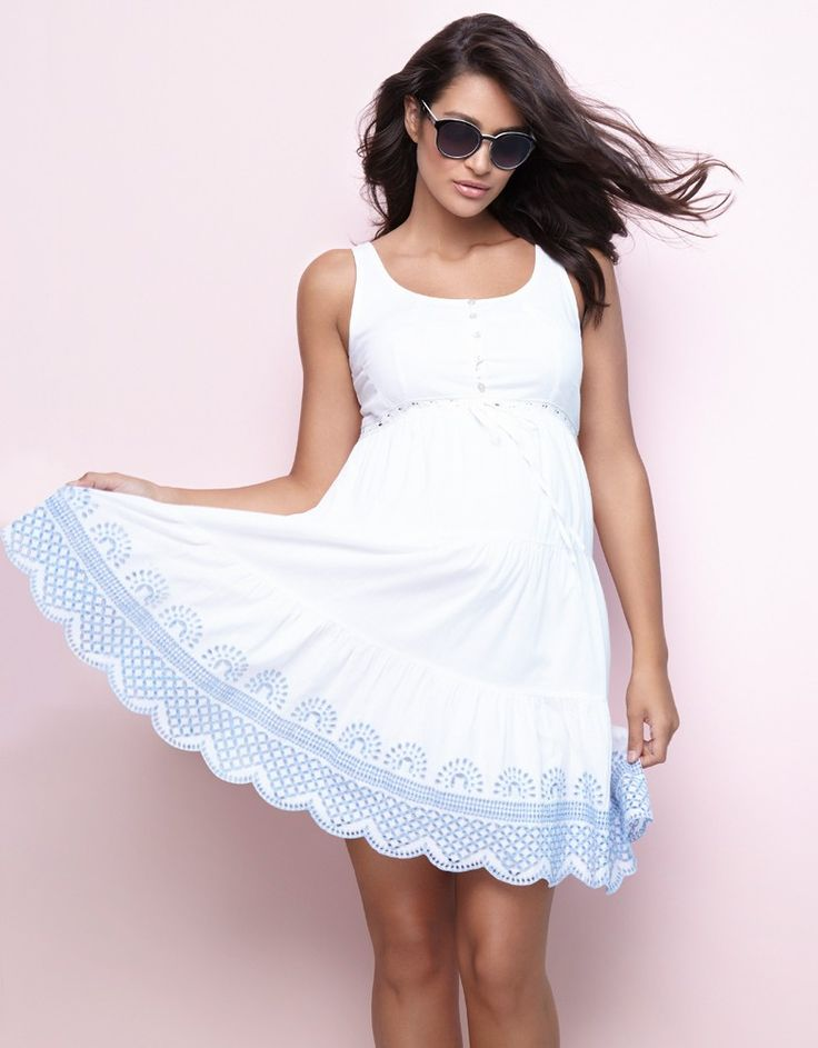 100% cotton   Mother of pearl buttons for nursing   Stretch panel at the back   Empire waist drawstring ribbon   Embroidered crochet detailing    No mama's summer wardrobe would be complete without a little cotton sundress, and ours is specifically designed to work with your new curves. 100% cotton and fully lined, this white maternity dress provides a feminine drape and a flexible fit for every stage of pregnancy. A discreet stretch panel at the back offers plenty of room to grow, while…