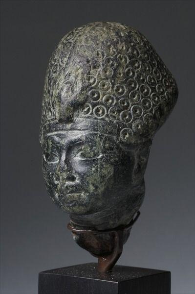 Head of Amenhotep III (green steatite), reign 1391-1353 BC.