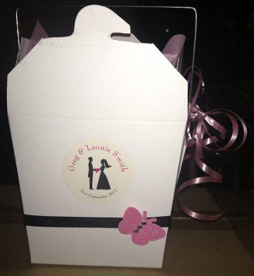 Simple ribbon and sticker detail make these plain noodle boxes the perfect alternative to expensive bonbonniere gifts.