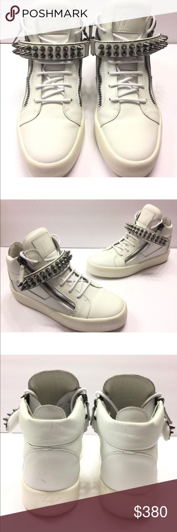 Giuseppe Zanotti Men's Studded Leather Sneaker Giuseppe Zanotti  White 41 EU 8 US -$995.00  Sold as-is no Box or Dust-Bag. Please Check All Pictures. Minor signs of wear, There is a Sku # written on the exterior sole to prevent Store Return. ( see photos for detail )  Details:  Giuseppe Zanotti mid-top sneaker in leather with gunmetal-tone hardware.  Round toe.  Lace-up front.  Dual side zip details.  Spike-studded grip strap.  Logo patch at tongue.  Padded collar with pull tab.  Leather…