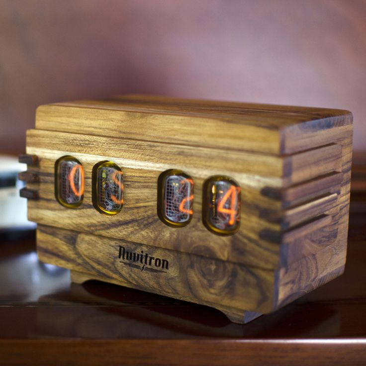 The Vintage Nixie Tube Clock - Volta #Nuvitron #gadget #nixie #homedecor #artdeco #stairtreads #handcrafted #designplusmagazine #woodcarving #chisel  #vintagetimepiece #nixietubeclock #Retrotimepiece #vintagenixieclock #clock
