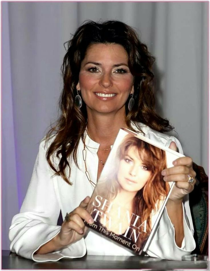 Shania Twain with her FROM THIS MOMENT Biography.