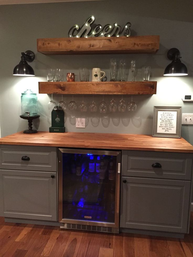 Rustic bar with IKEA cabinets and beverage center #Basement bar