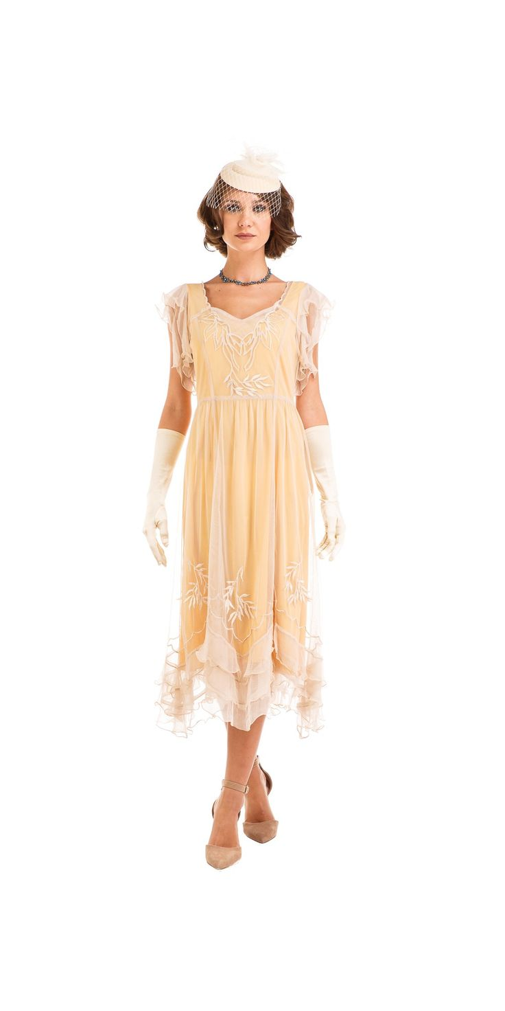 Why pick the Olivia 1920s Flapper Style Dress in Lemon by Nataya for your next Jazz Age themed event? Well, because it's flattering, light, fun, and flawlessly embellished