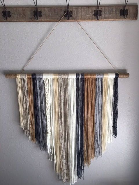 This beautiful wall hanging would look perfect in any shabby-chic home, cottage, farmhouse or nursery! It is handcrafted with different pieces of yarn, of different colors and textures. This yarn wall hanging is a great statement piece adding a new style for any room in your home! It comes ready to hang, with the jute cord wrapped securely on the dowel rod for long lasting durability. This piece measures approximately 36 in width and approximately 37 in height, not including the jute cord…