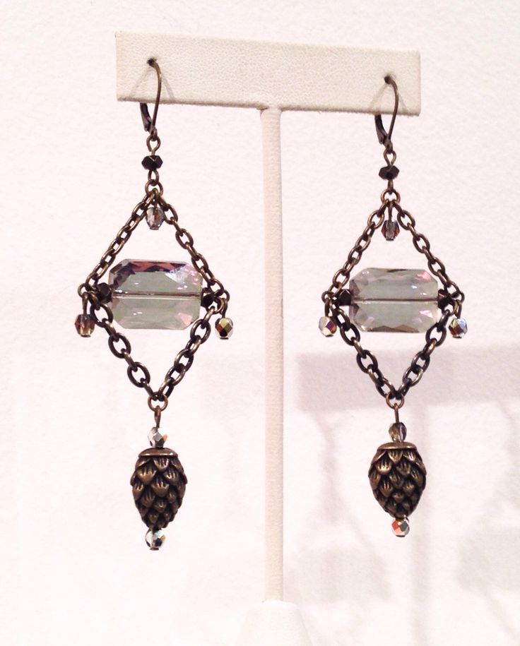 Chandelier earrings with pinecone drops and aurora borealis crystals antiqued brass finish by cheriebeadle on Etsy https://www.etsy.com/listing/223344733/chandelier-earrings-with-pinecone-drops