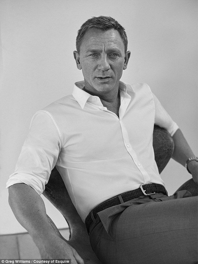 Smouldering: Daniel Craig gets candid about James Bond as he poses in a brooding shoot for...