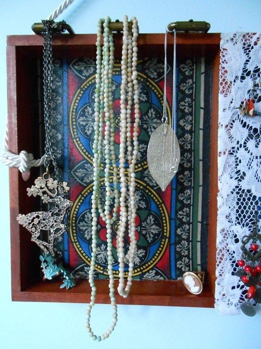 Necklace hanger, made from antique-style belt buckles