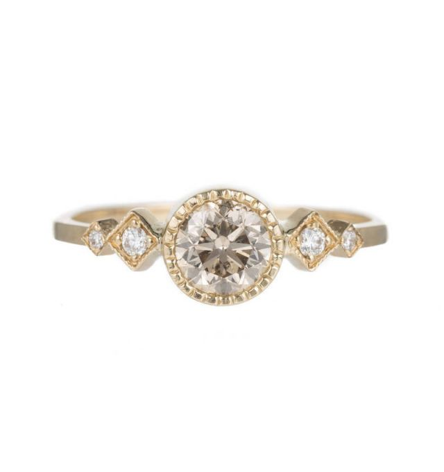 don't usually like stones on the side, but this is interesting | Jennie Kwon Champagne Diamond Solitaire Echo Ring