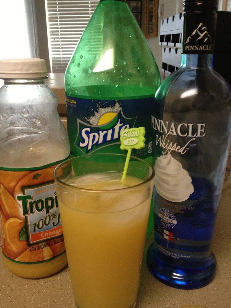 Vodka Wednesday: Orange Dreamsicle  2 shots whipped vodka,  2 shots Orange Juice,  Fill with Sprite.    SOOOO DELISH!