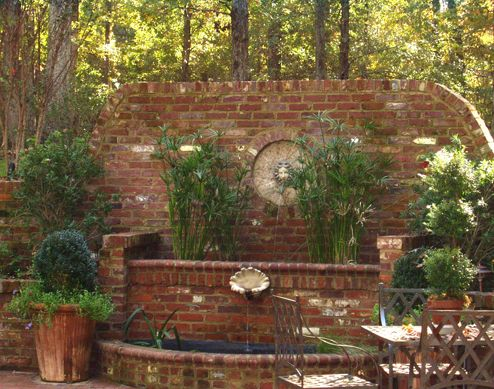 Brick water feature and raised planters.