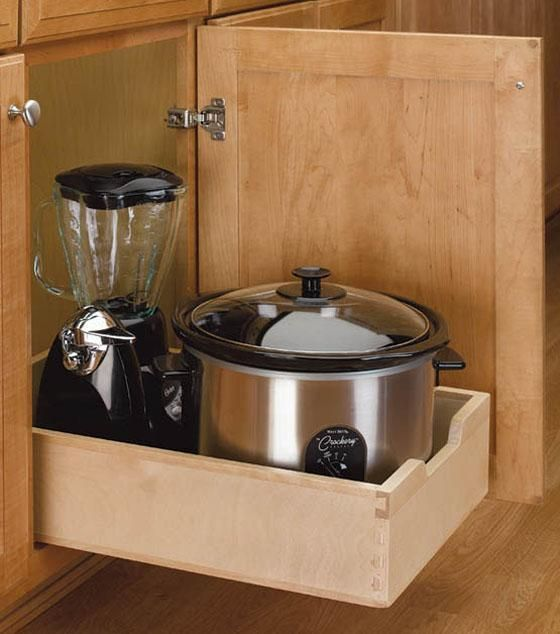 a pull out wood drawer is easy to install and adds functionality to any kitchen