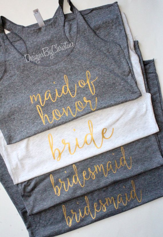 Bridal Party Gold Racerback tanks Heather Gray/ Heather White - Metallic Gold - Semi Matte Finish  I used a shirt that is super soft, lightweight for a comfy fit. Perfect for all your on-the-go activities while making a fashion statement in style. Made with one of a kind handwritten beautiful scripts.  Sizes XS-XL AVAILABLE Colors: Brown Heather White Heather Gray Navy Vintage Black Hot Pink Pink Red Turquoise Purple  ***please note all tanks have a slight heather look to them***  HOW TO…