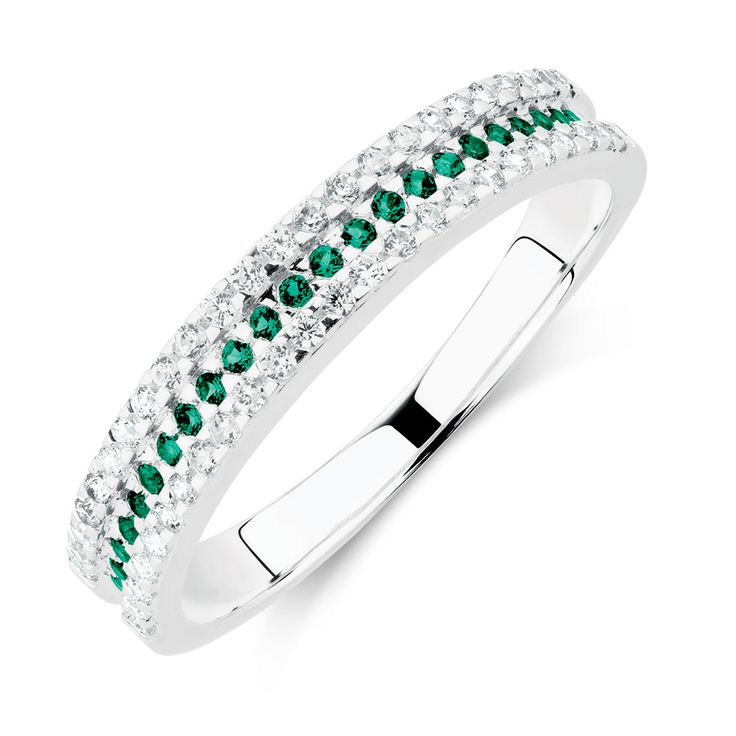 Featuring vivid green cubic zirconias framed by two rows of glittering white cubic zirconia, this fashionable sterling silver ring will add a touch of colour to any outfit.
