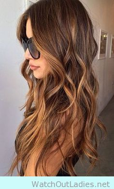 Long hair with beach waves with caramel highlights