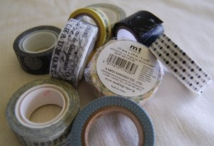 """What is Washi Tape? An Overview of Paper and Tissue Tape. In the past 12 months or so, """"washi tape"""" has taken over the scrapbooking and stationery world. For those who haven't heard of it, I thought I'd give you an overview of just what it is and perhaps why you might want to try it. For starters, """"Washi Tape"""" comes from Japan, is a paper tape that comes in pretty colors and patterns. It comes on a roll like regular sticky tape,: Artsy Craftsi, 12 Months, Crafts Ideas, Thoughts I D, Tissue Tape, Washi Tape, Products, Cool Stuff, Paper Tape"""