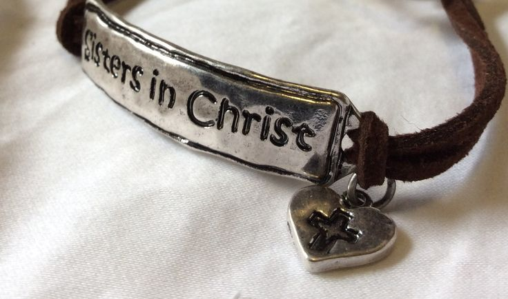 """Dainty suede style 9"""" bracelet featuring """"Sisters in Christ"""" focal. Lead compliant."""