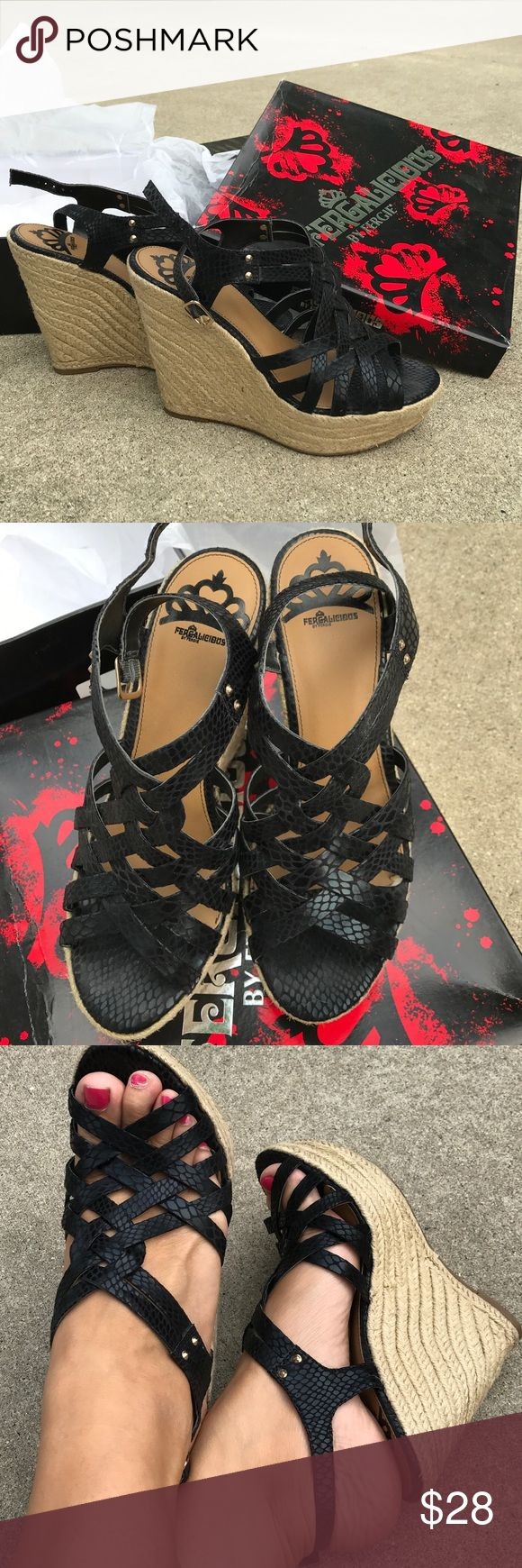 """Fergalicious by Fergie - 9.5 black sandals Worn less than a handful of times. Beautiful black faux snakeskin print platforms. Super comfortable! Size 9.5 fits true to size. Comes from a smoke free, dog friendly home Measurements - Heel Height-4.50"""" (at the heights point)   Platform-3/4"""" Fergalicious Shoes"""