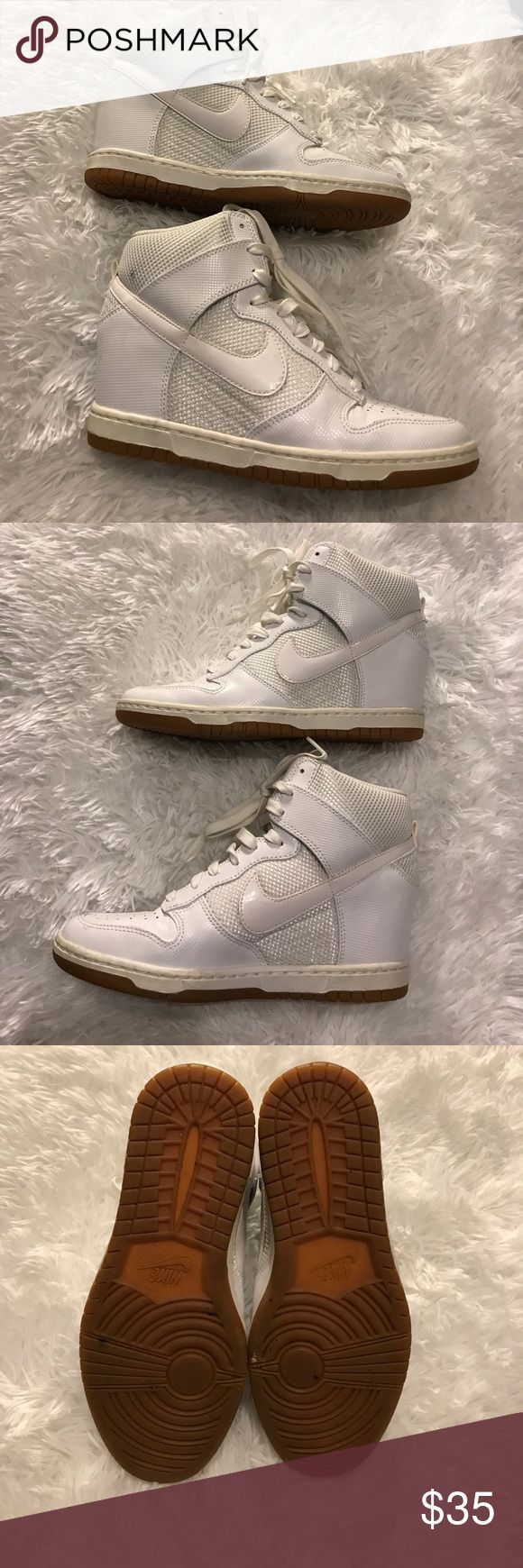 Nike Sky Hi Dunk Gently used white Nike Sky Hi Dunks. There is only a slight crease, and there is one small blemish on the right shoe near your ankle as shown in first photo. Reasonable offers accepted! Nike Shoes Sneakers