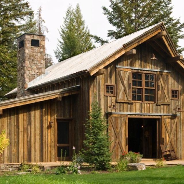 Rustic cabin in swan valley made mainly of wood and stone for Wood barn homes