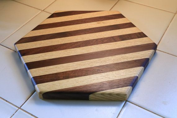 This Modern geometric Cheese Board/serving tray is a the perfect addition to any modern Kitchen! Made from jointed solid Walnut and Ash Hardwoods.