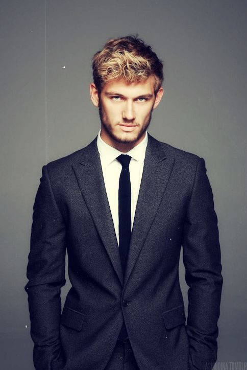 You can never go wrong with a black skinny tie and a modern cut suit.