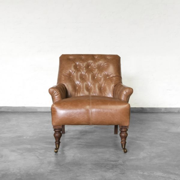 Gulmarg Leather Arm Chair: We got inspired by the beautiful Gulmarg town in the Kashmir Valley. This charming sofa has a carefully hand-tufted, quilted look covered with our exclusive and supple natural leather. The internal frame and the tapered, handcrafted ringed legs are made in solid kiln dried wood to last years of usage. These legs are accented by high quality imported brass casters in front.